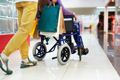 Shopping with disable girlfriend Stock Image