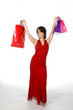 Shopping diva. Pretty teen in red gown with shopping bags Stock Photos