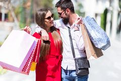Happy young couple shopping in the city royalty free stock image