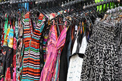 Shopping for dresses. Colorful dresses at a market stall. Famous Khao San street in Bangkok, Thailand royalty free stock photos