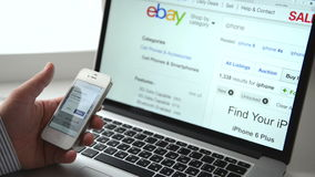 Shopping on eBay with iphone stock footage