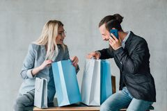 Shopping enjoyment casual leisure couple sit bags royalty free stock image