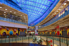 Shopping and entertainment complex Avia park in Moscow. Interior shopping center.glass roof. illuminated blue light Stock Image