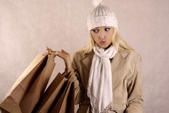 Shopper in winter coat with bags Stock Photography