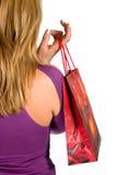 shopping för påseflickaholding Arkivfoton