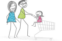 Shopping in family. A family with the father, the mother and a child sitting in a caddy, do shopping at the supermarket Royalty Free Stock Photos