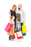 Shopping family. Of husband, wife and two young daughters Royalty Free Stock Photography