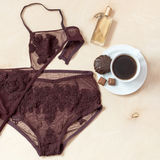 Shopping and fashion concept. Set of glamorous stylish sexy lace lingerie with chocolate sweets, morning coffee, woman Stock Photo
