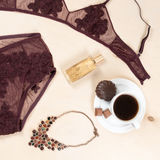 Shopping and fashion concept. Set of glamorous stylish sexy lace lingerie with chocolate sweets, morning coffee, woman Royalty Free Stock Photos