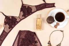 Shopping and fashion concept. Set of glamorous stylish sexy lace lingerie with chocolate sweets, morning coffee, woman Royalty Free Stock Images