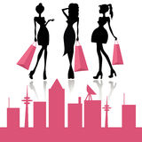 Shopping fashion girls. Silhouettes of fashion girls with shopping bags. vector illustration Royalty Free Stock Images