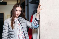 Shopping, fashion, style, sale, shopping, business and people. concept beautiful happy young woman in clothing store. business royalty free stock photography