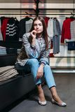 Shopping, fashion, style, sale, shopping, business and people. concept beautiful happy young woman in clothing store. business royalty free stock photo