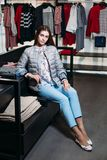 Shopping, fashion, style, sale, shopping, business and people. concept beautiful happy young woman in clothing store. business royalty free stock image