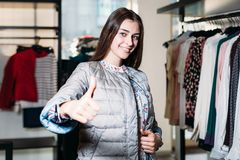 Shopping, fashion, style, selling, shopping, business and people. Concept beautiful happy young woman showing class in clothing stock photos