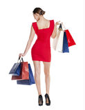 Shopping. Fashion young woman portrait isolated. Happy girl hold Stock Image