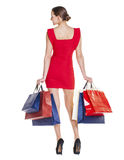 Shopping. Fashion young woman portrait isolated. Happy girl hold Royalty Free Stock Photos