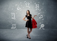 Shopping female with bags and drawn icons Stock Photos