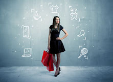 Shopping female with bags and drawn icons Royalty Free Stock Image