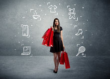 Shopping female with bags and drawn icons Royalty Free Stock Photos