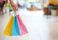 Shopping! Female Hand Holding Colorful Shopping Bags Royalty Free Stock Images