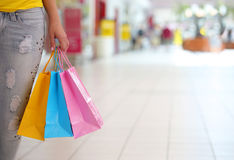 Shopping! Female Hand Holding Colorful Shopping Bags Stock Photo