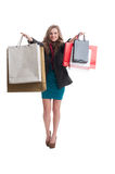 Shopping female showing the bags Royalty Free Stock Photos