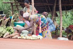 Shopping for food products. Akoupé, ivory coast-August 20, 2015: sellers of food products display their wares at the roadside for sale Stock Photo