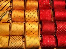 Shopping for formal dress. Rows of colorful fashionable and elegant ties. Man's wear Stock Photos