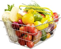 Ripe fresh vegetables in shopping basket on white royalty free stock photography