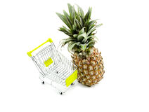 Shopping fresh pineapple with trolley Stock Photos