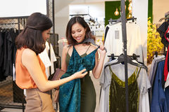 Shopping with friend. Two beautiful young ladies enjoying shopping together Stock Photography