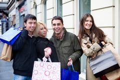 Shopping with friends. Two couples going shopping at the city center stock photos
