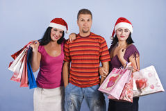 Shopping friends with Christmas bags Stock Photo