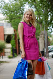 Shopping Gal. With lots of purchases Royalty Free Stock Image
