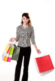 Shopping galore. Young woman with many shopping bags Royalty Free Stock Image