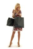 Shopping girl. Lovely beauty with shopping bags Stock Photography