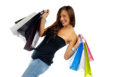 Shopping girl. Beautiful girl with shopping bags isolated on white Royalty Free Stock Photos