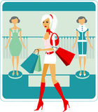 Shopping girl. Beautiful shopping girl in clothes store Stock Images
