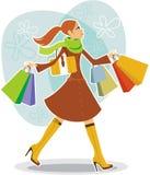 Shopping girl. Beautiful girl holding shopping bags Royalty Free Stock Photos