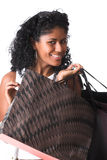 Shopping girl. Beautiful brazilian woman with lots of shopping bags and a happy face Royalty Free Stock Images