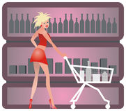 Shopping girl. Cute girl with shopping cart in liquor store Stock Photography