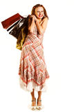Shopping girl. Happy girl with shopping bags Royalty Free Stock Images
