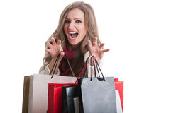 Shopping girl acting like a cat Royalty Free Stock Image