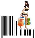 Shopping girl with bag on bar code Royalty Free Stock Photography