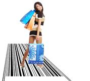 Shopping girl with bag on bar code royalty free stock photos