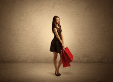 Shopping girl with bags and clear background Royalty Free Stock Images