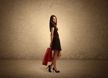 Shopping girl with bags and clear background Royalty Free Stock Image