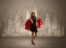 Shopping girl with bags in drawn city Royalty Free Stock Photo