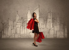 Shopping girl with bags in drawn city Royalty Free Stock Photography